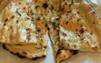 Indian bread called garlic naan at diamond palace